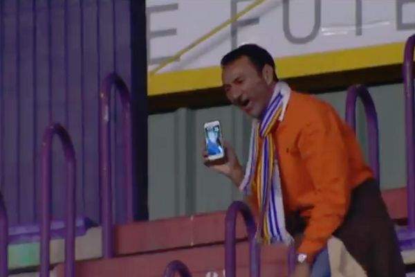 Espanyol fan spends the game on a video call to his partner