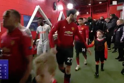 Marouane Fellaini loses his mascot as the teams walk out of the tunnel for Man Utd's 1-0 Champions League win over Young Boys