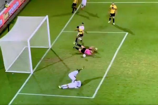 Maccabi Petah Tikva's Habib Habibou scores against Maccabi Netanya after waiting with an injured player