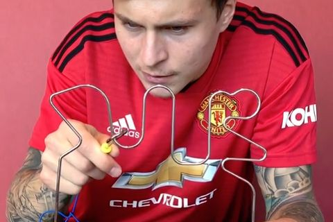 Victor Lindelöf plays a buzz wire game for Manchester United's Instagram account