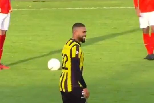 A player laughs at a hired streaker interrupting Rijnsburgse Boys vs Amsterdamsche