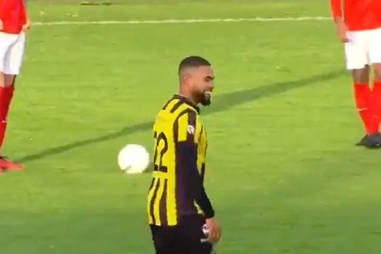A player laughs at a hired streaker interrupting Rijnsburgse Boys vs Amsterdamsche