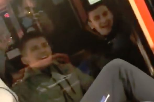 The police tackles a fan banging on a bus window after Hearts 0-0 Hibernian