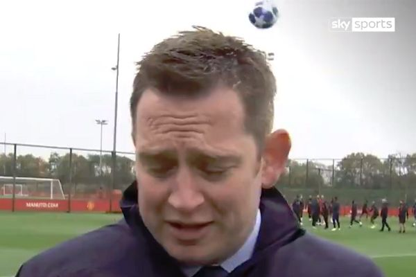 Marcus Rashford kicks a ball at a Sky Sports reporter covering Manchester United training