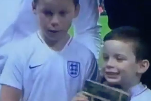 Wayne Rooney's children quarrel during a pre-match photo before his farewell international against USA