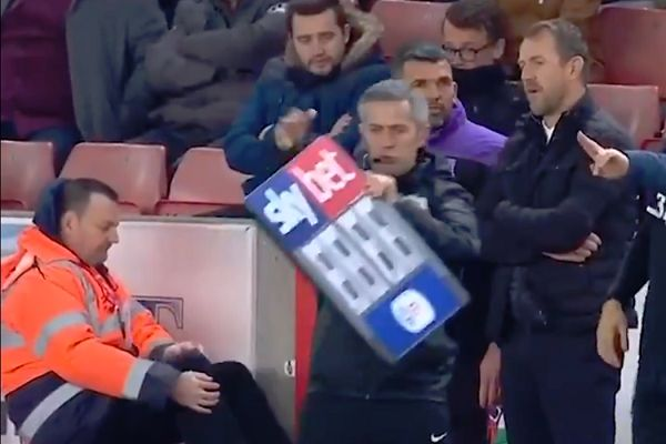 The substitutes board almost blows away at Stoke during their match against Middlesbrough