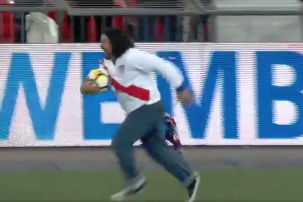 Fan tripped and fell during the half-time relay race at England vs USA in Wembley
