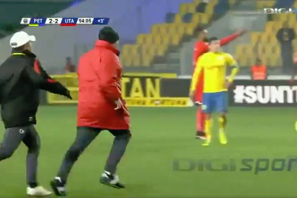 UTA Arad manager Ionuţ Popa runs after his player Norbert Janos who missed last-minute chance against Petrolul