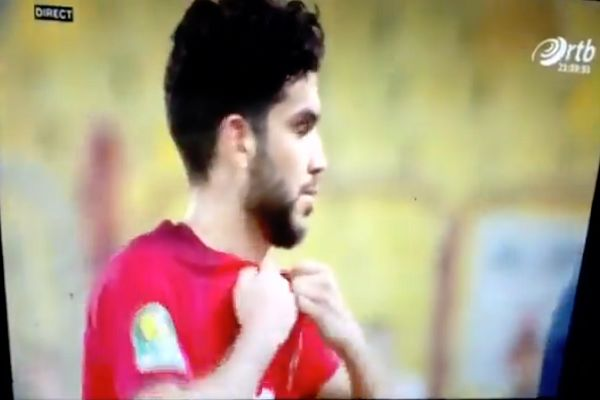 Al Ahly player Walid Azaro rips his own shirt in the CAF Champions League final first leg