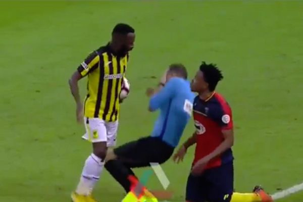 Assistant referee is knocked down by a player during Al-Ittihad 2-2 Al-Hazem in Saudi Arabia