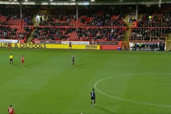 Fan heads ball back from the upper tier of the Main Stand at Aberdeen during their 5-1 win over Dundee