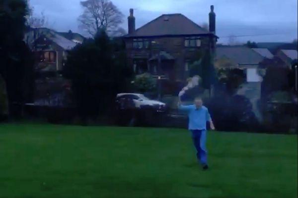 A dad runs around his garden celebrating Leeds' win at Aston Villa