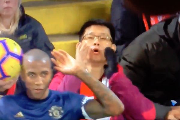 Liverpool fan boos Ashley Young's throw-in at Anfield during their 3-1 win over Man Utd