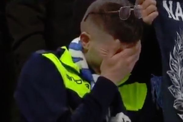 A Napoli fan cries in the first-half of a 1-0 defeat to Liverpool in the Champions League