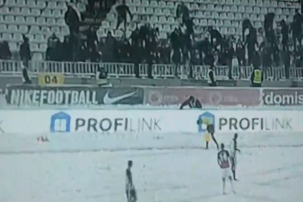 Partizan Belgrade fans throw snowballs at an assistant referee during their side's 0-0 draw with Mačva Šabac