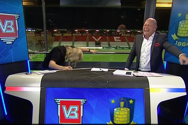 Danish pundit Stig Tøfting farts in studio and laughs while his TV3 Sport colleagues walk away