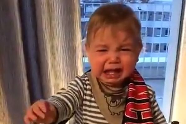 Baby boy bursts into tears when a Bayern Munich scarf is placed on his shoulders