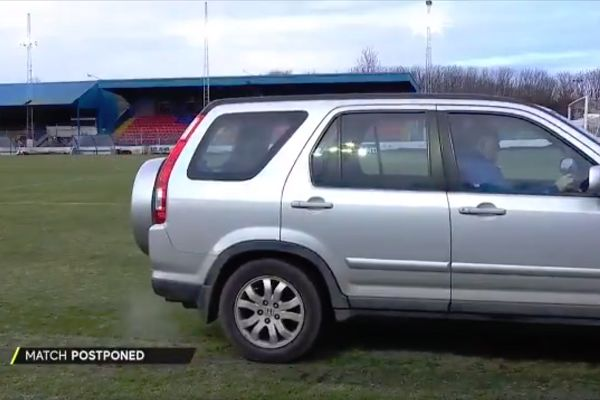 Car driven on pitch at Cowdenbeath as Scottish Cup game against Rangers is postponed due to a frozen pitch