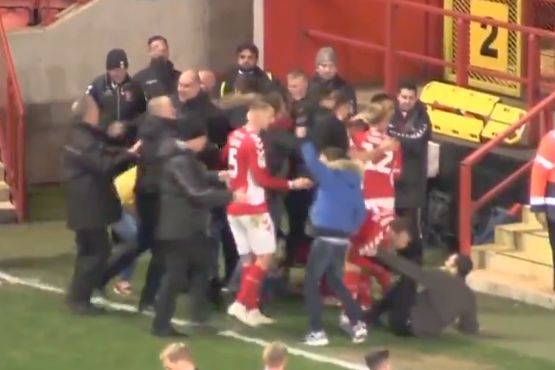 Charlton fan slides into player Krystian Bielik during goal celebrations in 1-0 win over Accrington Stanley