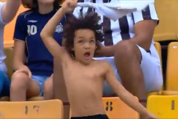 Young fan swings his Santos shirt above his head during a 2-0 win over São Paulo