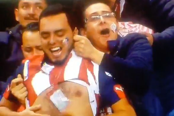 Guadalajara fan lifts up another fan's shirt after goal against Cafetaleros de Tapachula in Copa MX