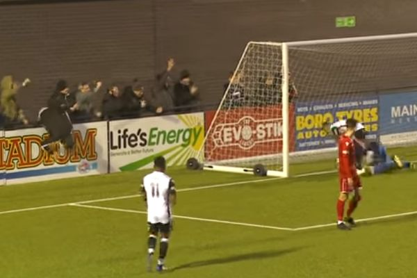 Hednesford fan falls over advertising hoarding after goal at Scarborough Athletic