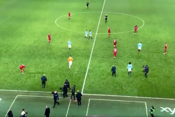 Stewards chase after Benjamin Mendy, confusing him with a pitch invader after Man City 2-1 Liverpool
