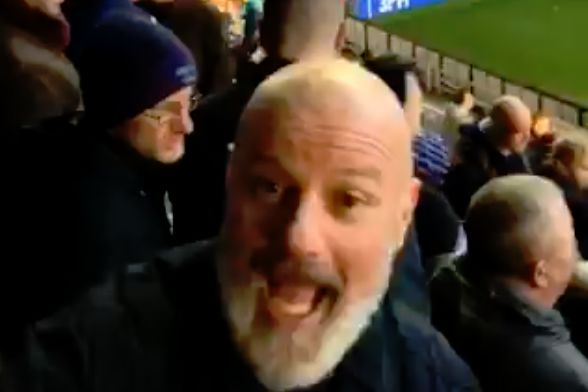 A Sheffield United fan falls off his seat at Wigan prior to 0-3 win on New Year's Day