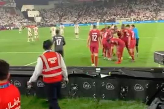 Fans throw shoes at the Qatar players after their goal in an Asian Cup semi-final against UAE