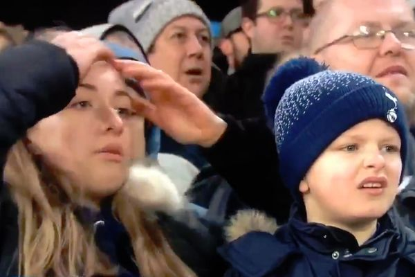 Two young Spurs fans at Crystal Palace react to Kieran Trippier's missed penalty