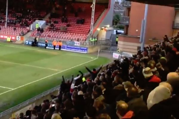 Fans cheer a squirrel on the pitch in Leyton Orient's 3-0 win over Maidstone United