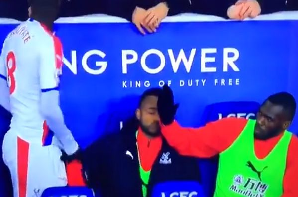 Cheikhou Kouyaté leaves Christian Benteke hanging on a high five on the subs bench during Leicester 1-4 Crystal Palace