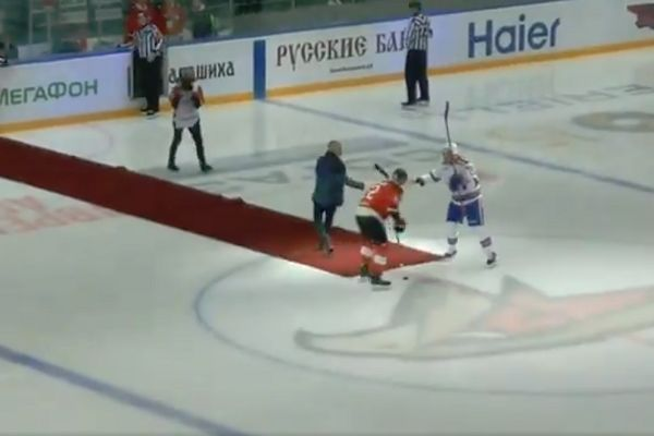José Mourinho slips after dropping the puck at an ice hockey game in Russia