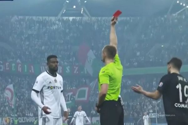 Legia Warsaw's William Rémy is shown a straight red card after VAR rescinds his second yellow card and the ref calls him back onto the pitch in a Polish Ekstraklasa defeat to Cracovia