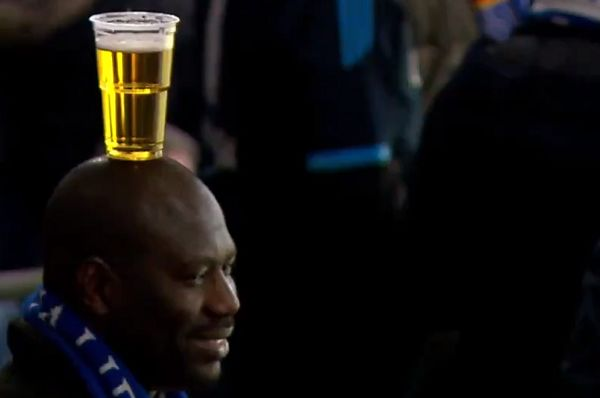Schalke fan carries a beer on his head at the 2-3 Champions League defeat to Man City