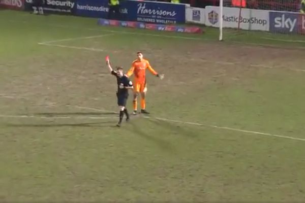 Accrington Stanley goalkeeper Dimitar Evtimov is shown a red card for throwing a bottle into the crowd against Blackpool