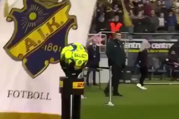 Man holding AIK flag walks into stand for match ball before 0-0 draw with Östersunds