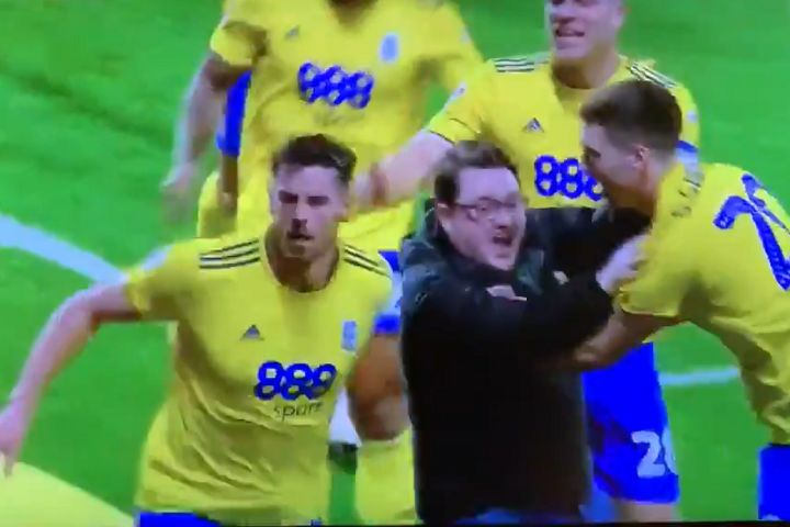 A pitch invader slips while celebrating Jutkiewicz's goal for Birmingham in a 3-2 defeat at West Brom