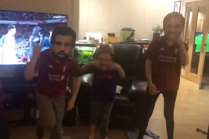 Children in Liverpool masks dance at home after beating Bayern Munich in the Champions League round of 16