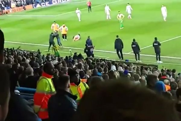 West Brom head coach Darren Moore catches a pitch invader during a 4-0 defeat at Leeds United