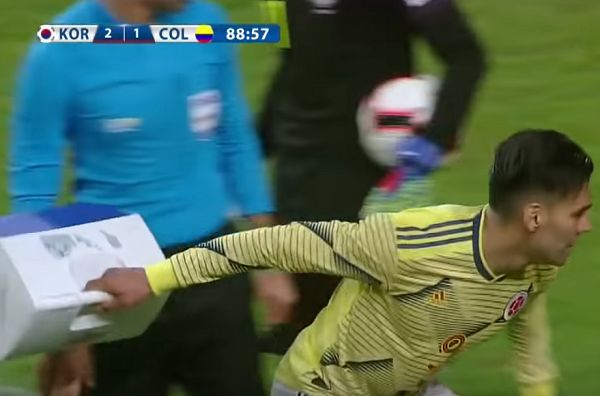 Radamel Falcao throws South Korea's first aid kit away in frustration during Colombia's 2-1 friendly defeat