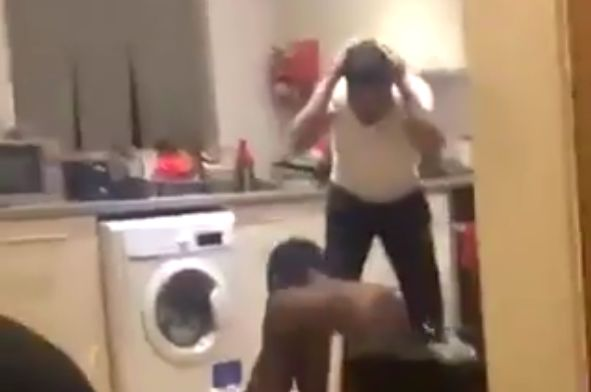 A fan hits his friend on the head with a pan while celebrating Man Utd penalty winner at PSG