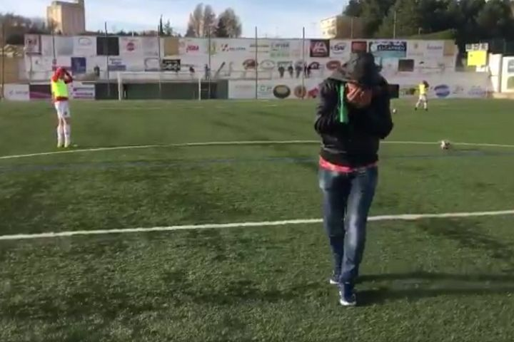 Guijuelo fan's shot hits a substitute during the half-time entertainment in game against SS Reyes