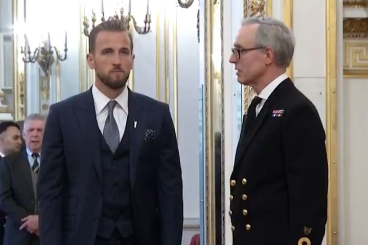 A young man was falling asleep as Harry Kane collected his MBE from Prince William at Buckingham Palace