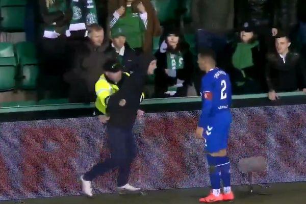 Pitch invader at Hibernian confronts Rangers' James Tavernier