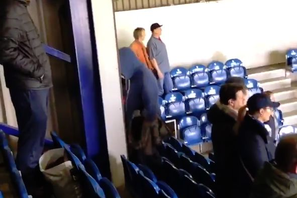 A QPR fan bangs his head against the stand wall to lead a chant at Loftus Road during a 0-0 draw with Stoke