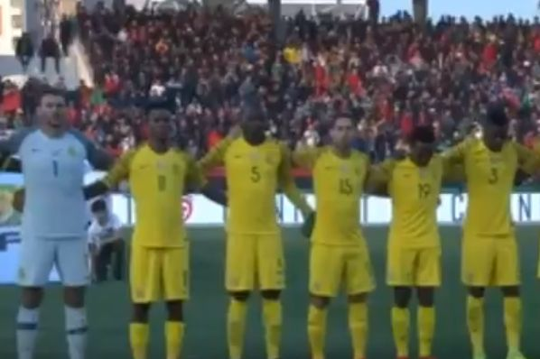South Africa line up for their national anthem, played on a Huawei phone, before the AFCON qualifier against Libya