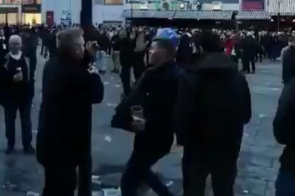 Spurs fan falls over trying to take a ball being thrown amongst supporters in Germany ahead of a Champions League tie at Borussia Dortmund