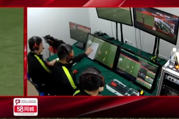 A piece of paper is used to judge an offside call in the VAR control room during a Chinese League One match between Shanghai Shenxin and Heilongjiang