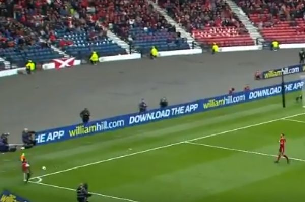 Ball boy intercepts the ball before it goes out of play during the Scottish Cup final between Aberdeen and Celtic